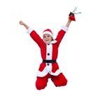 跳跃圣诞老人的服装的愉快的男孩-被隔绝 免版税库存图片