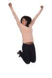 跳跃在喜悦的少妇 免版税库存照片