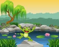 跳跃在岩石的动画片愉快的青蛙 免版税库存图片