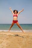 跳跃在海滩 图库摄影