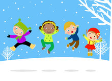 跳跃在雪的小组孩子 免版税库存照片