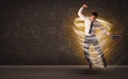 跳跃在龙卷风概念的愉快的商人 免版税库存图片