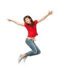 跳跃的十几岁的女孩 免版税库存图片