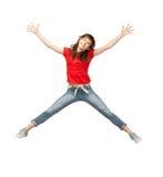 跳跃的十几岁的女孩 库存照片