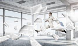 跳跃的商人在办公室 混合画法 免版税库存图片