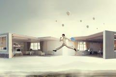 跳跃的商人在办公室 混合画法 免版税图库摄影