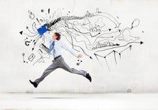 跳跃的商人 免版税库存图片