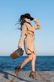 跳跃的时尚女孩 免版税图库摄影