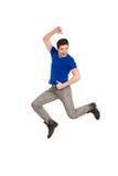 跳跃的男学生。 免版税图库摄影