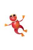 跳跃的青蛙由红色苹果制成 库存照片