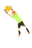 跳跃年轻男孩足球的守门员从目标保存 免版税库存照片