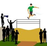 跳过障碍的运动员 免版税库存照片