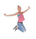 跳进空气的俏丽的妇女 免版税库存照片