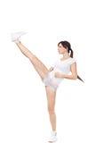 踢与腿的美丽的女孩隔绝在白色背景 免版税库存图片