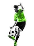 踢剪影的足球足球运动员年轻人 库存照片