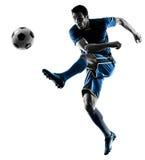 踢剪影的足球运动员人被隔绝 免版税图库摄影
