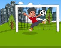 踢在公园动画片的孩子足球 图库摄影