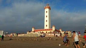 踢在海滩的足球 库存照片