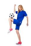 踢橄榄球的妇女 免版税图库摄影