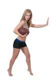 踢橄榄球的妇女 免版税库存图片