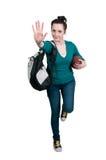 踢橄榄球的妇女 图库摄影