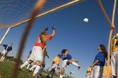 踢球的女孩在足球比赛期间 免版税库存图片