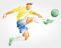 踢球的足球运动员飞行 免版税库存照片
