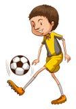 踢足球的男孩的一个色的剪影 库存照片