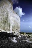 踩着旋转的峭壁空白白色 库存照片