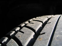 踩轮胎 库存图片