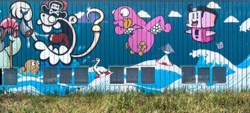 蹲的大厦街道画墙壁在海牙,荷兰 库存照片