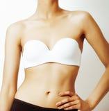 身体局部,在白色背景,新的饮食概念的皮包骨头的混血儿tann腹部 免版税库存图片