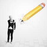 身体面具的人与一支大手拉的铅笔 免版税库存图片