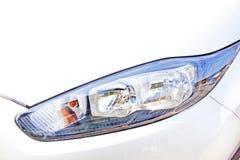 车前面前灯汇编左边特写镜头  免版税图库摄影