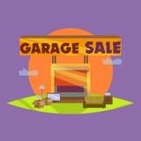 车库或庭院旧货出售与标志、箱子和家庭项目 免版税库存图片