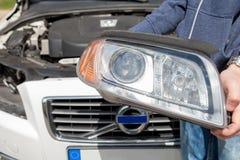 车灯从汽车去除 免版税库存图片