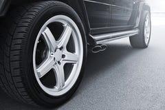 车轮在沥青背景关闭  背景汽车设计疲倦向量 车轮特写镜头 库存图片