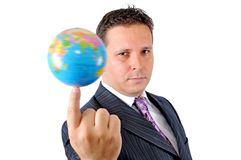 转动世界的商人在他的手指技巧  免版税库存图片