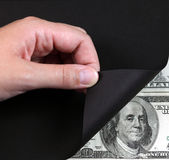 转动黑页和金钱 免版税库存照片
