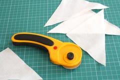 转台式切割工的织品 库存图片