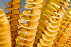转弯切片在竹子的土豆插入物 免版税库存图片