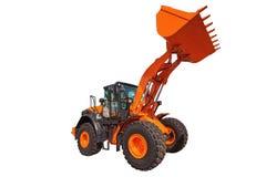 轮子装载者挖掘机被隔绝的建筑机械设备 库存照片