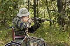 轮椅猎人 免版税库存图片