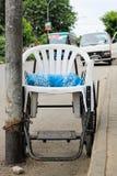 轮椅由塑料椅子制成 免版税图库摄影