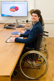 轮椅的人在业务会议期间 免版税图库摄影