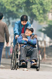 轮椅的老中国人,广州,中国 库存照片