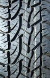轮胎踩冬天 免版税库存照片