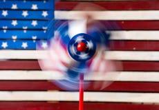 轮转焰火或陀螺在美国旗子前面 免版税图库摄影