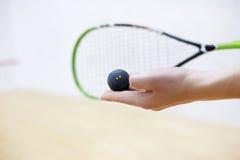 软式墙网球和球在手上 免版税库存图片