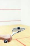软式墙网球和球在手中 免版税库存照片